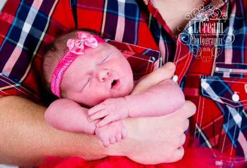 Chilling in Daddy's arms, a shot from a newborn photo session