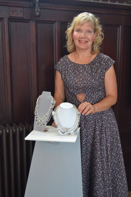 Kathy with her 3D displays at Drawn to the Valley's Summer Show, 2015