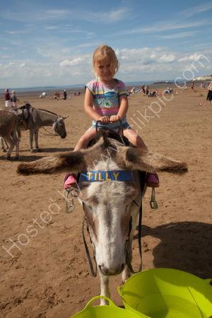 Lara on donkey on beach