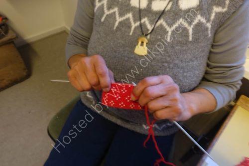 Ittoqqortoomiit Inuit Village, Scoresby Sound- local woman knitting.