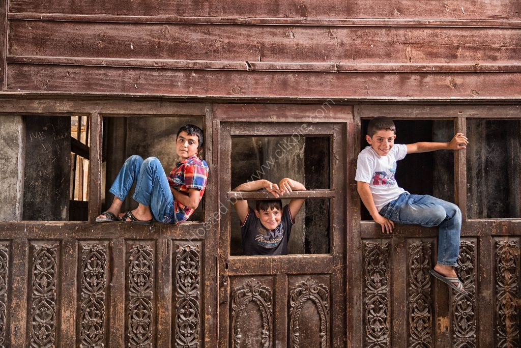 Turkish boys in old church
