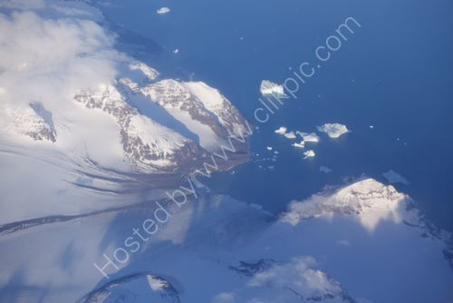 Flying between Iceland and Greenland