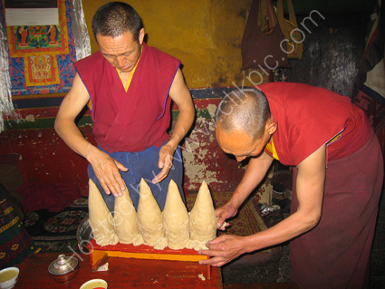 Monks making candles