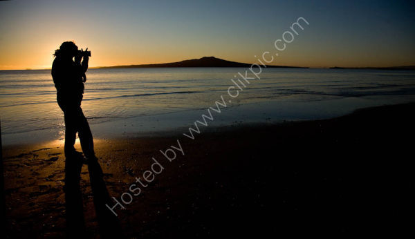 Rangitoto at Sunrise with  Photogrpaher