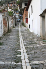 Narrow steep street in Berat, Albania