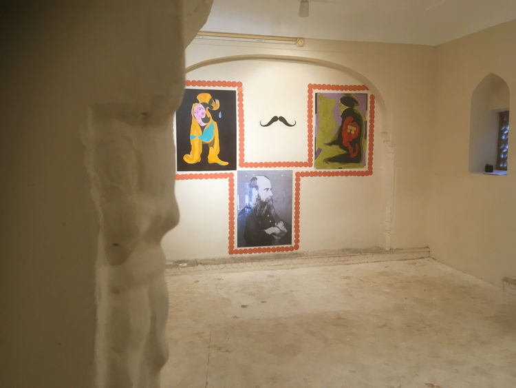Installation view of Hobson-Jobson in Museum of Legacies, showing paintings in alcove
