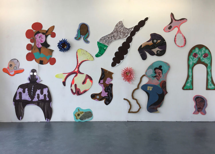 Installation of painted wooden cutouts at Outpost Studio Norwich