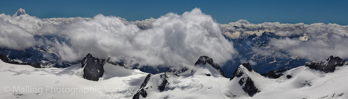 2 Clouds Over the Alps by David Alston