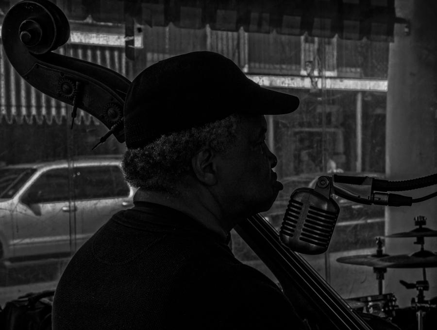bassist and singer at Cafe Monet