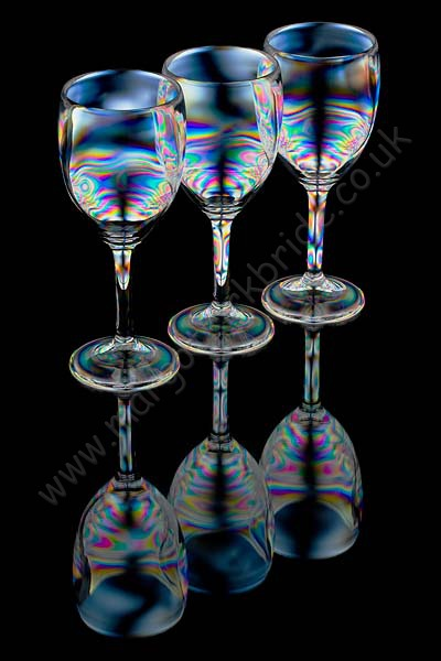 Three wine glasses full reflection
