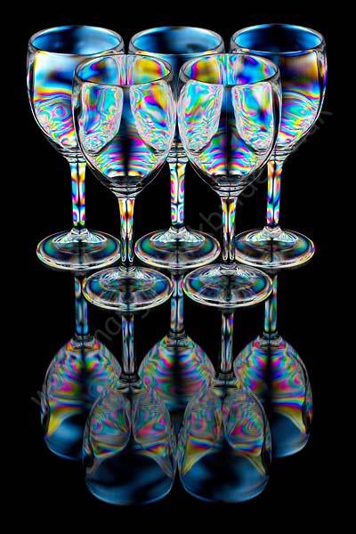 Five wine glasses full reflection