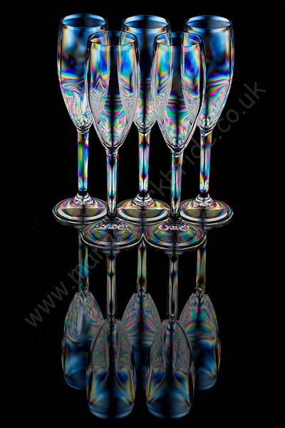 Five champagne glasses full reflection