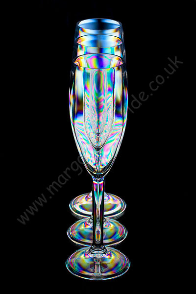 Three champagne flutes.