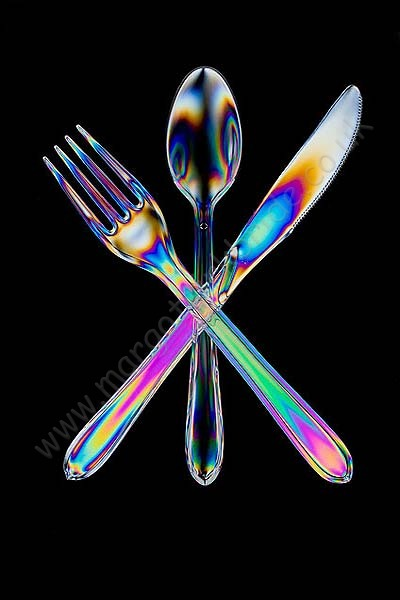 Crossed knife, fork and spoon.