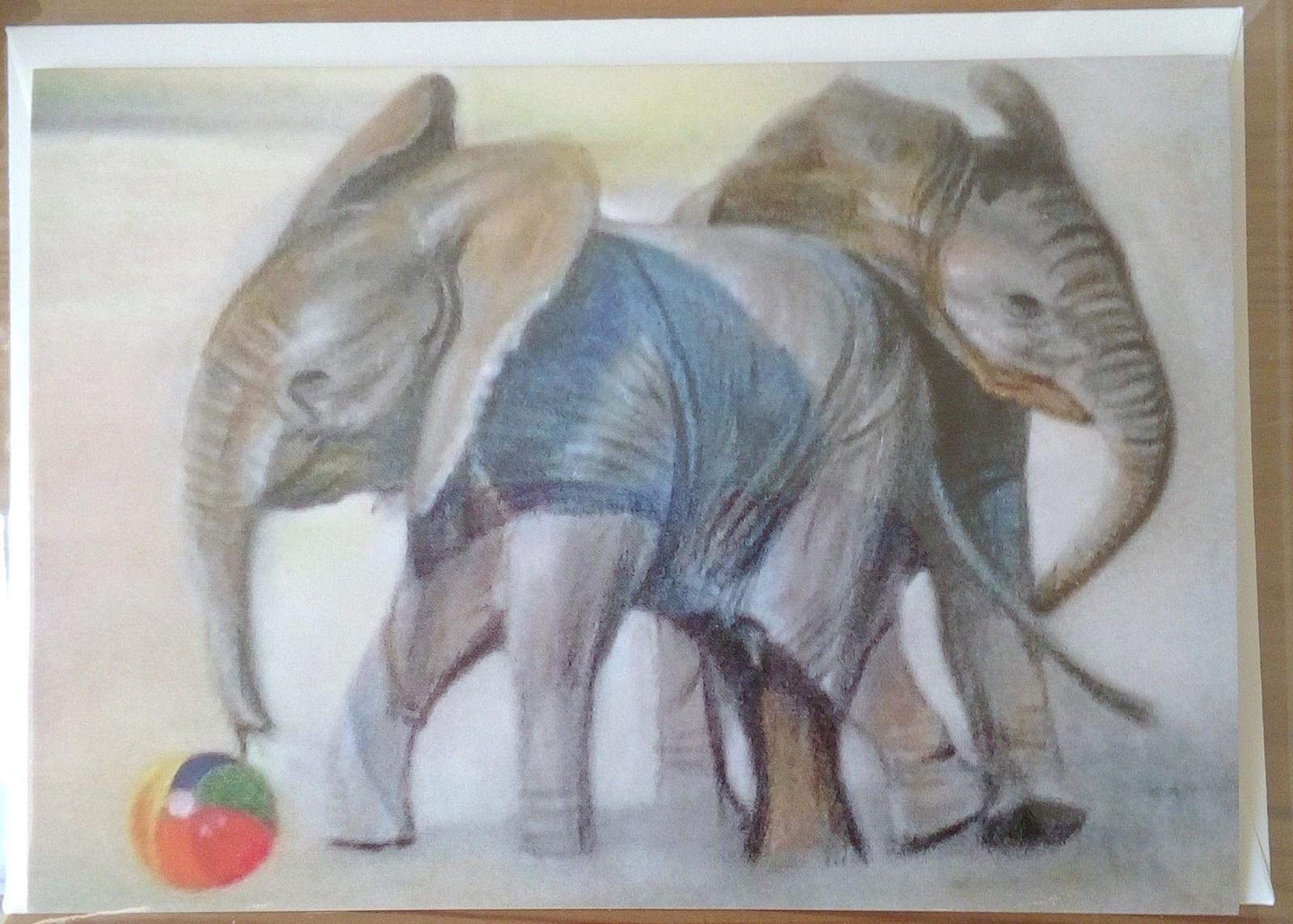 Baby Elephants playing football
