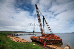 Abandoned floating crane and pier
