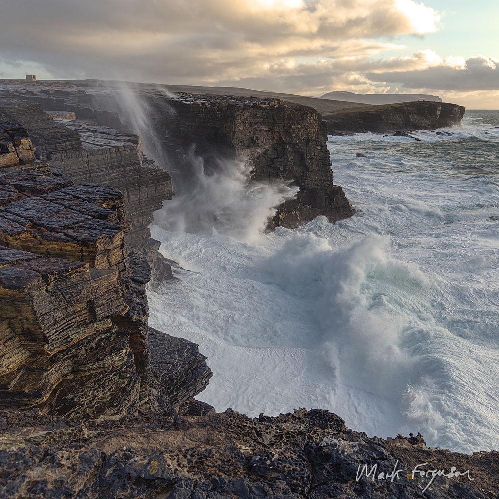 Battered cliffs