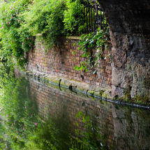 Canal Wall With Reflections