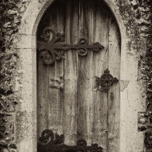 Old Church Door With Ornate Hinges