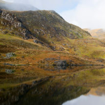 Green Welsh Mountains With Reflection