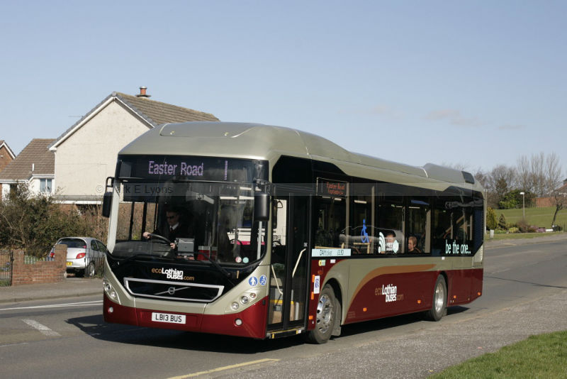 Lothian Buses 1, with a suitable select registration, is seen passing Drum Brae South in Edinburgh during its first week of service