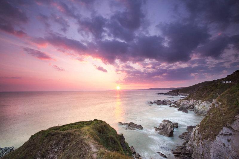 Sunset over Freathy Beach Whitsand Bay Cornwall UK