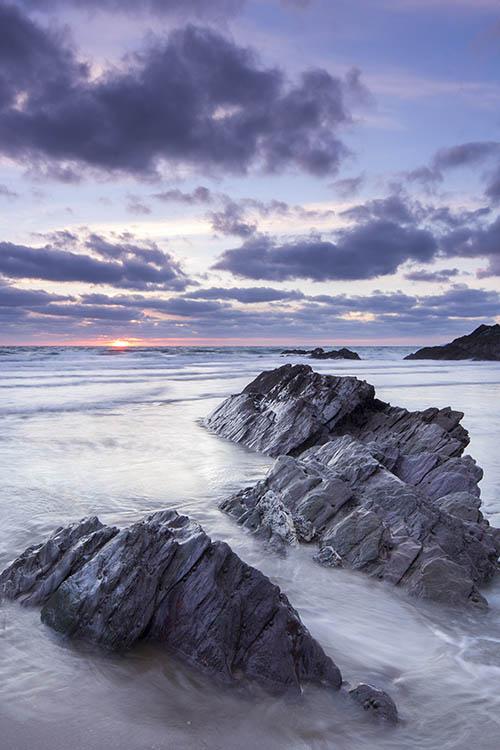 Sunset over Sharrow Beach Whitsand Bay Cornwall UK.