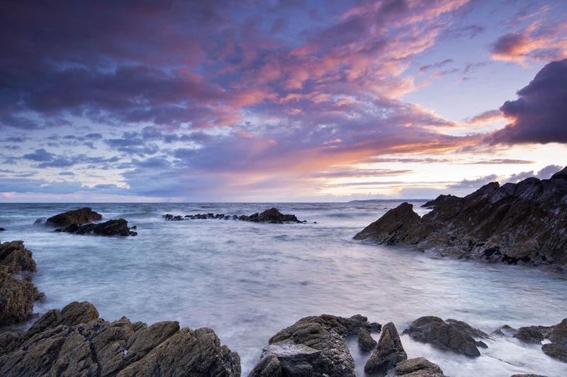 Sunset over Sharrow Beach Whitsand Bay Cornwall