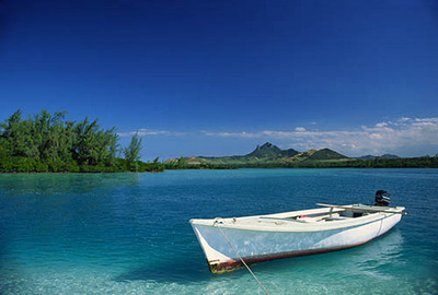 Boat in the clear blue waters of Mauritius