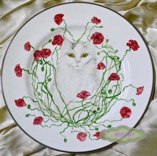 "Chippy was doing a spot of modeling for a china plate. An idea for the "" Cat Band "" came to mind....."