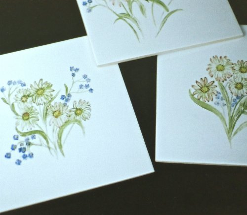 Hand Painted Tiles from former commission. Simple daisy design for a cottage.