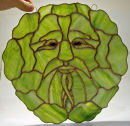 Tiffany stained glass green man window hanging by Gary Carr.