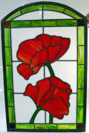 Stained glass 'flower' fire screen by Gillian Ashbury.