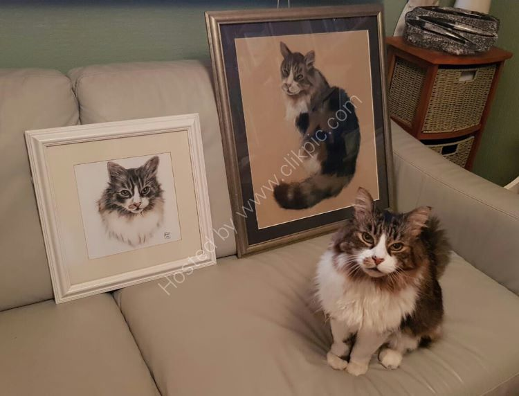 Angus alongside his portraits