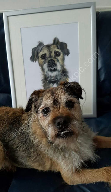 Grissom, the border terrier, alongside his portrait