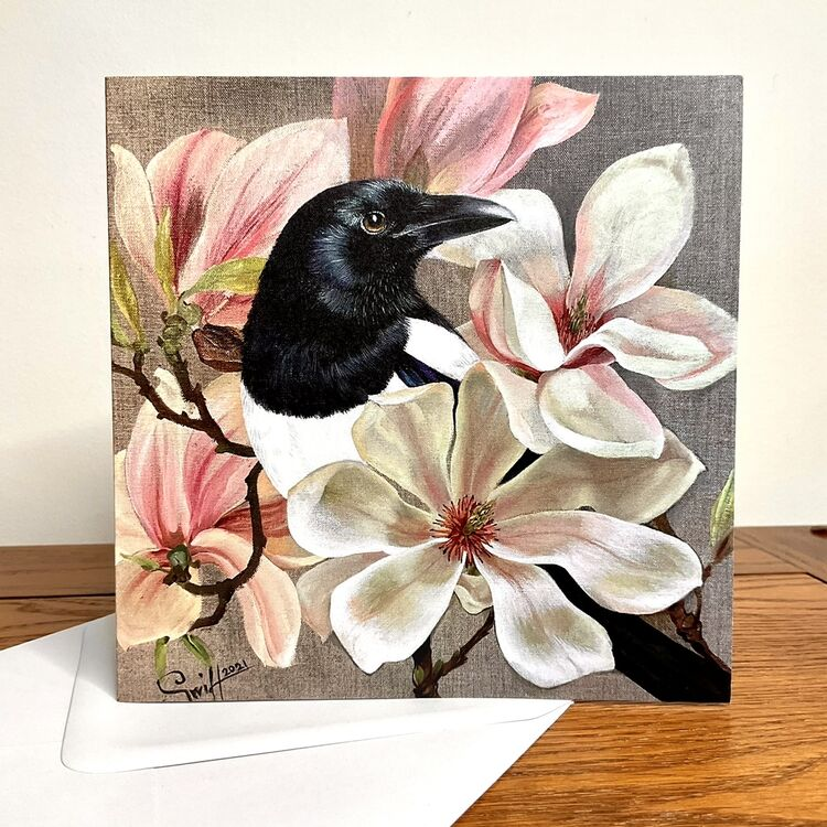 Magpie in blooming magnolias pink and white, spring painting printed on cards