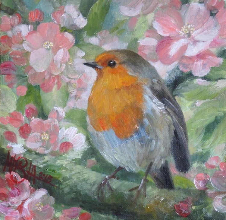 Robin in apple blossom