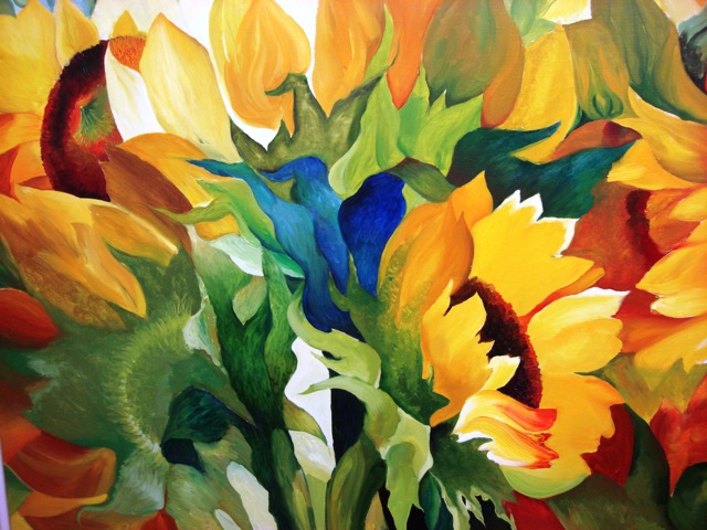 Sunflowers in bright colours bathed in sun