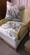 £1200.English 'Bergere' chair, 1900, beech frame stripped, new cane work, traditionally built and covered with an artist linen and French printed linen. £1200.00 Sofa also available.