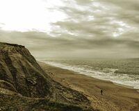 One man walks on an empty beach (1 of 1)