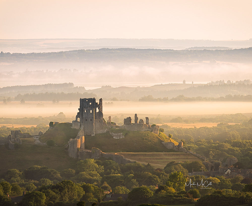 Corfe Castle at dawn, Dorset, England