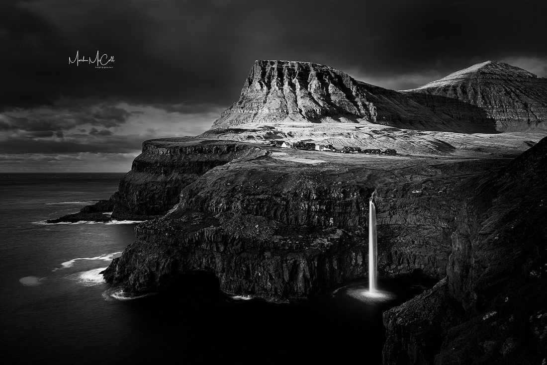Gasadalur and Mulafossur waterfal (mono), Faroe Islands