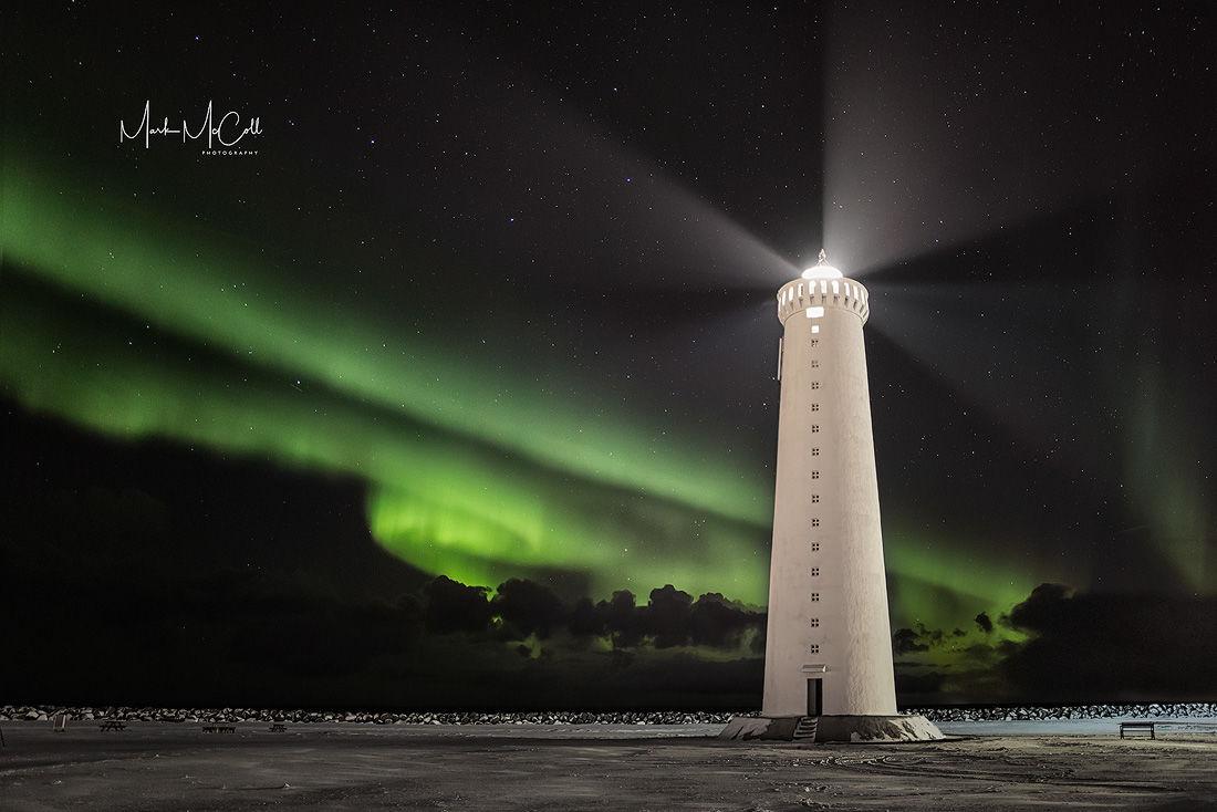 Lighthouse and aurora, Iceland
