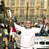 Olympic Torch Bearer at Parliament Square London 2012