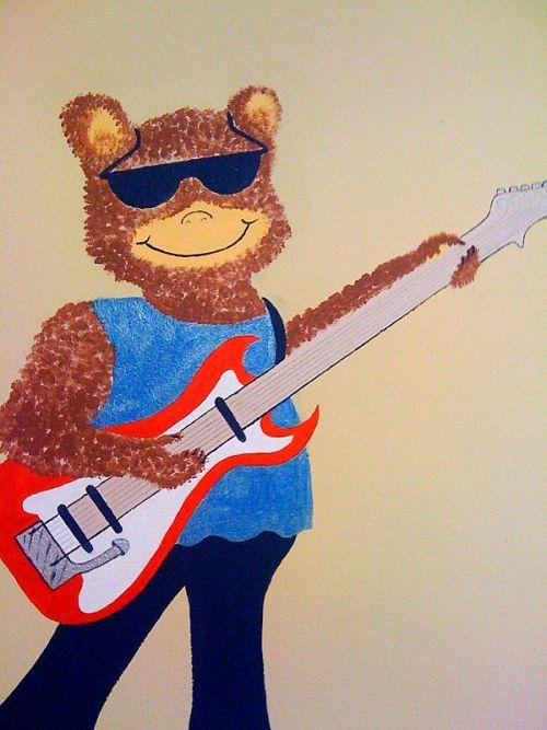 Tom Bear on the guitar