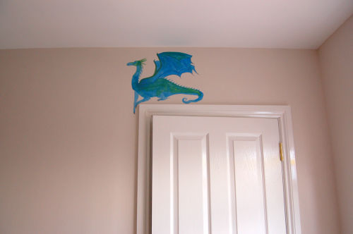 Dragon above doorway with woodwork painted.