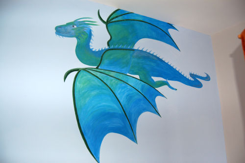 Large flying dragon over bed.