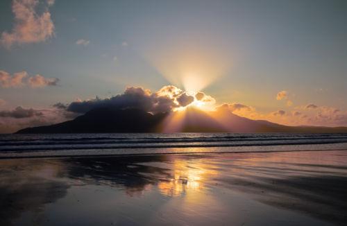 crepuscular rays over rum