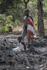 Charcoal gatherers, Gambia