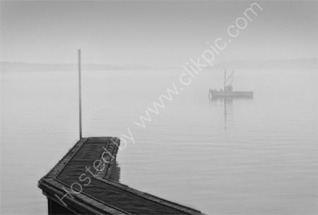 Jetty and Boat In The Mist